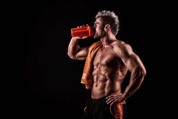 Young Man Drinking Protein Shake