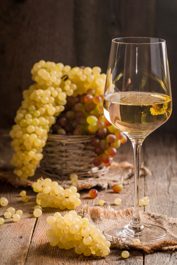 White Wine and Green Grapes in the Background